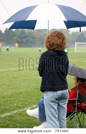 Soccer Mom Watching Game in Rain