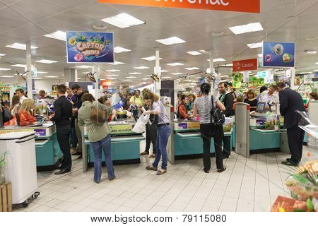 GENEVA - SEP 15: checkout counter in supermarket on September 15, 2014 in Geneva, Switzerland. Geneva is the second most populous city in Switzerland and is the most populous city of Romandy