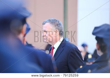 Mayor Bill De Blasio files past NYPD