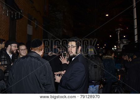 Chabad Lubavitch members at memorial