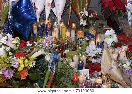 Flowers, candles & balloons at memorial