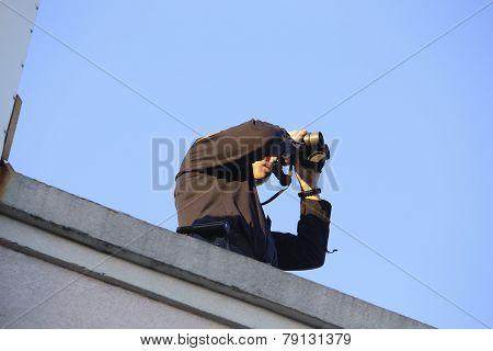 Rooftop security with binoculars
