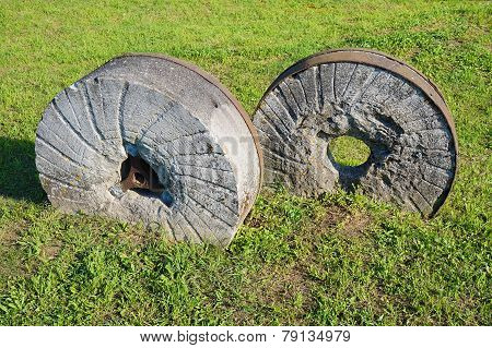 ancient millstone on the grass, natural background