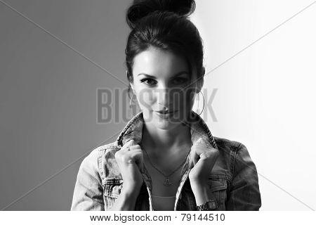 confident model holding denim collar with retro lighting