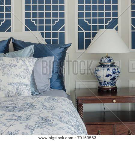 Pillows On Luxury King Size Bed With Lamp In Bedroom