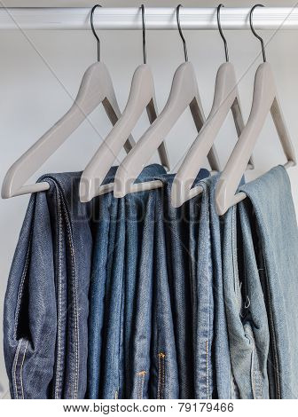 Row Of Blue Jeans On Hangers