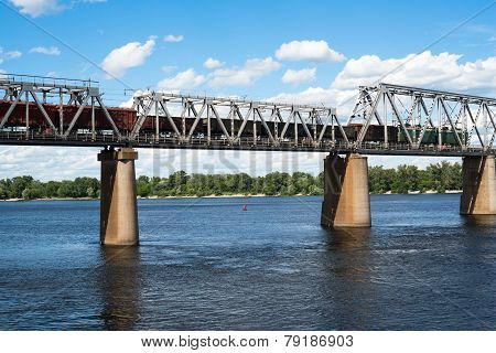 Railroad Bridge In Kyiv Across The Dnieper With Freight Train
