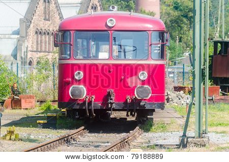 Red Bus On Rails