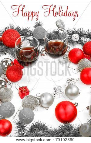 New Year Decoration With Pine Or Fir And Red Ornaments Balls With Two Glasses Of Wine