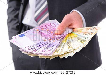 Businessman holding many euros banknotes