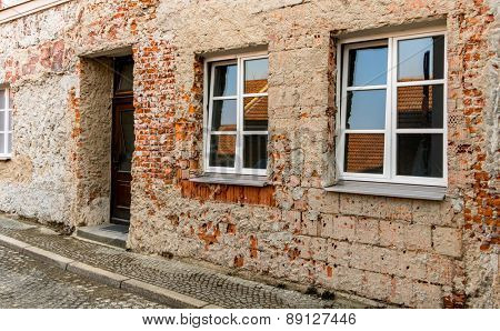 house masonry restoration, symbol of insulation, renovation, botch