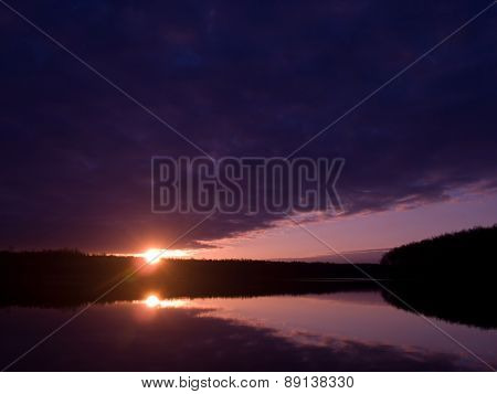 Dawn over the forest lake
