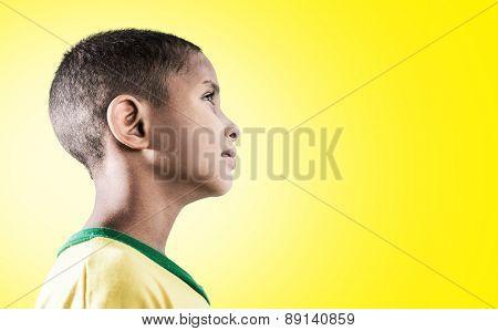 Brazilian little boy on yellow background