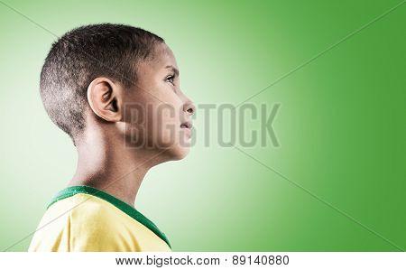 Brazilian little boy on green background