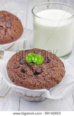 Delicious Chocolate Muffins With Choco Chips And Glass Of Milk