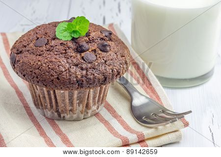 Delicious Chocolate Muffin With Choco Chips And Glass Of Milk Closeup