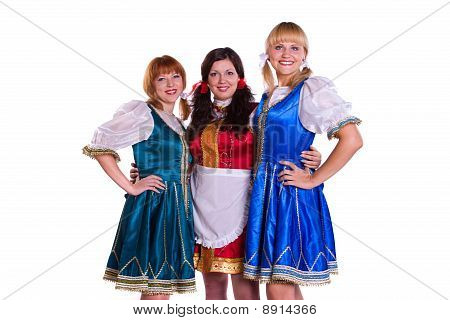"""Three German/Bavarian girl s with a traditional Oktoberfest """"MaГџkrug. Smiling woman in Bavarian drindl poster"""