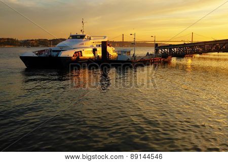 Ferryboat docked ina pier in Lisbon at Sunset poster