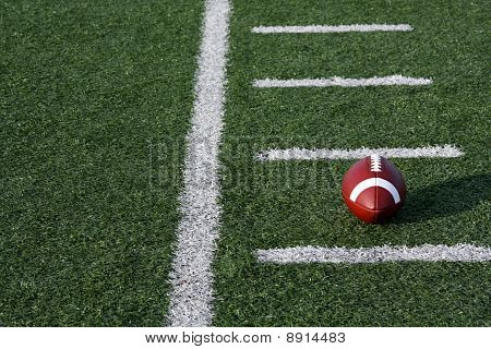 American Football On The Field With Yard Lines
