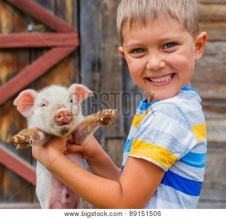 Boy with piglet