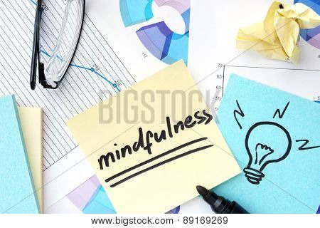 Papers with graphs and mindfulness concept.