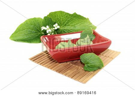 Wasabi With Leaf And Flower In A Red Bowl