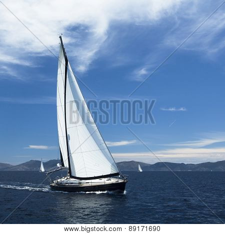 Sailing. Yacht sails with beautiful cloudless sky. Luxury yacht.