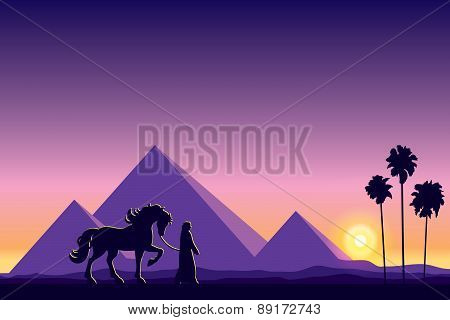 Egypt Great Pyramids With Silhouette Of Bedouin And Horse On Sunset Background