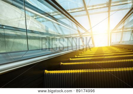Blurry modern escalator at sunny day.