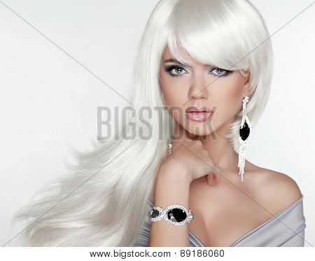 Beauty attractive blond portrait. White Long hair. Fashion girl model posing with Expensive Jewelry. poster