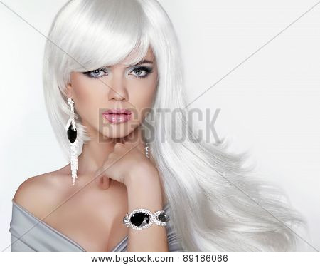 Long Hair. Fashion Blond Girl With White Wavy Hairstyle. Expensive Jewelry.beauty Portrait. Attracti