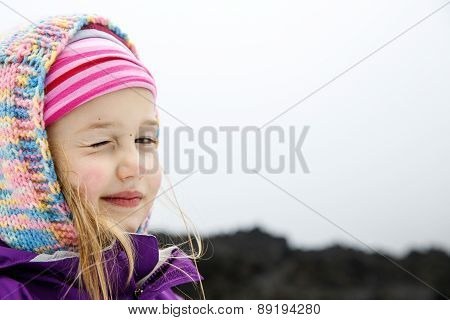Portrait Of Playful And Carefree Caucasian Girl