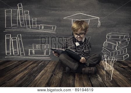 Child Little Boy In Glasses Reading Book Over School Black Board With Chalk Drawing, Kids Preschool