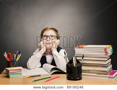 School Child Boy In Glasses Think In Classroom, Kid Primary Students Reading Book