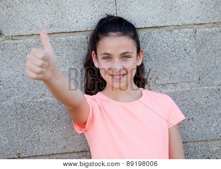 Portrait of a beautiful preteen girl with blue eyes saying Ok