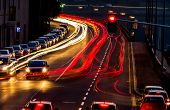 traffic in city at night, symbol of traffic, congestion, air pollution poster