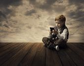 Child Using Mobile Phone Little Kid Boy Playing Cellular Smart Telephone in Hand poster