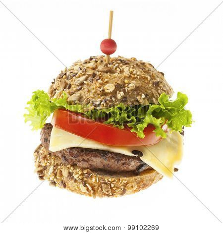 Gourmet hamburger with swiss cheese, fresh vegetables and multigrain bun isolated on white background