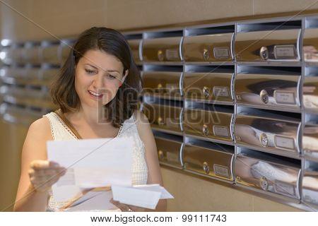 Woman Reading Correspondence