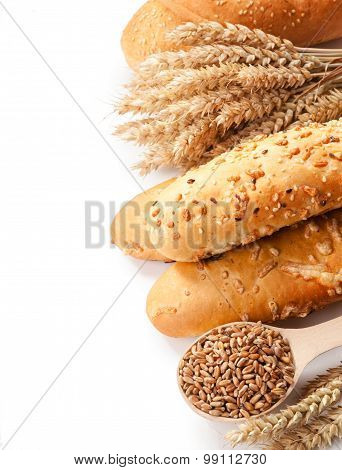 Bread, Ears And Grains Of Wheat On A White Background Isolation