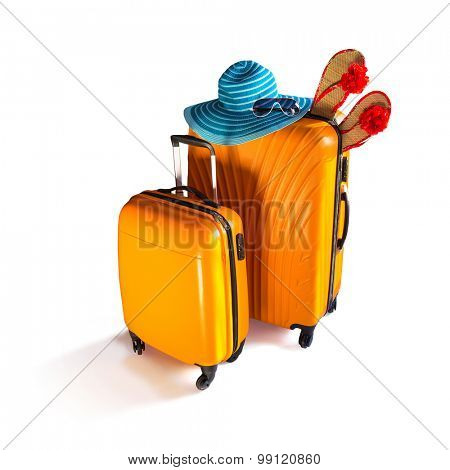 Baggage ready for travel. Orange luggage, hat and sunglasses isolated on white.