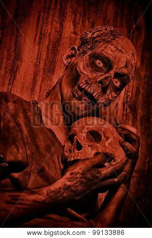 Frightening bloody zombie man with a skull in blood-red light. Halloween. poster