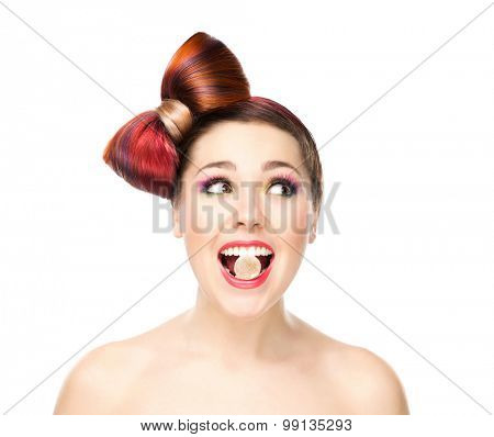 Attractive young girl eating jelly with a bow haircut.