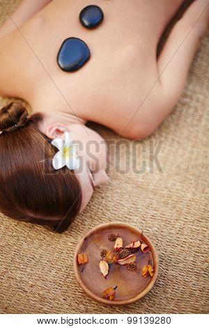 Lying woman during lastone massage