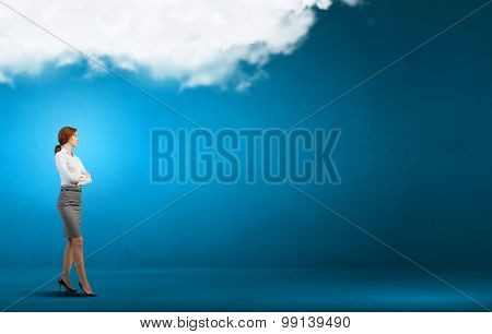 Confident pretty businesswoman with crossed arms on chest