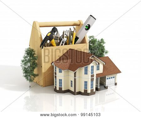 Concept Of Repair House. Repair And Construction Of The House. Tool Box Near A House With Trees.