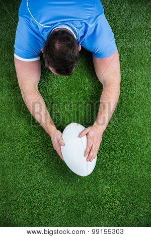 Rugby player scoring a try on astro turf grass