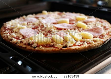 Frozen Pizza With Ham And Pineapple On The Plate