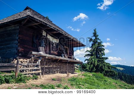 Traditional cheese making sheepfold in Romania building