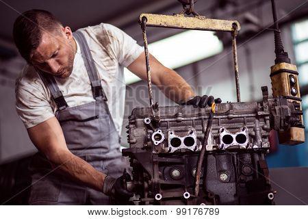 Car Engine Hanging On Hoist